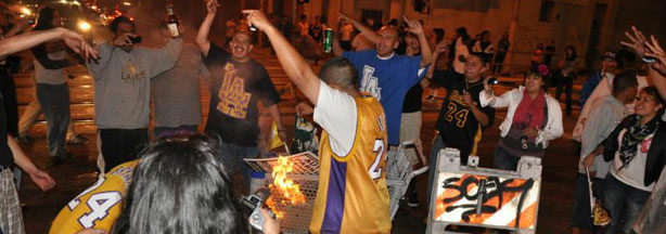 Fans cheer in the middle of the intersection at Figueroa Blvd and 11th St. in Downtown Los Angeles after a Laker victory in the NBA Finals on June 17, 2010