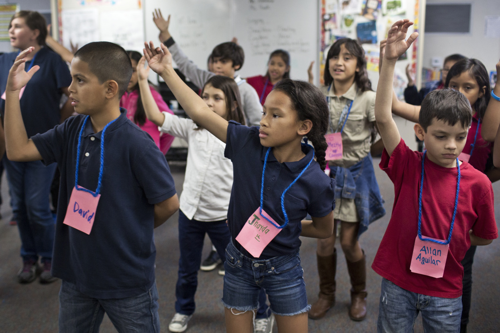 Students at Adelaide Price Elementary School practice choreography for