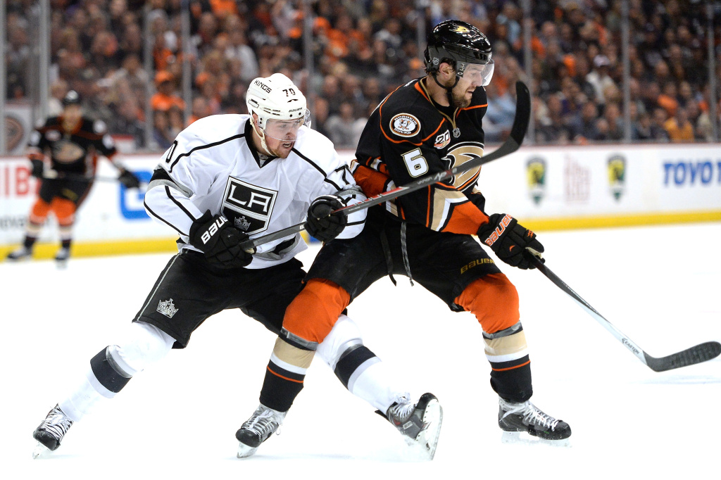 Tanner Pearson #70 of the Los Angeles Kings chases after the puck behind Ben Lovejoy #6 of the Anaheim Ducks during the second period in Game Two of the Second Round of the 2014 NHL Stanley Cup Playoffs at Honda Center on May 5, 2014 in Anaheim, California.  The Kings won 3-1.