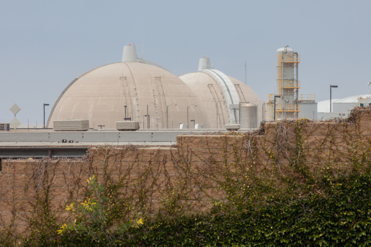 The Nuclear Regulatory Commission said Thursday it is holding a public meeting Sept. 26 in Carlsbad to talk about the decommissioning process for the San Onofre Nuclear Generating Station.  (Photo: The sun sets behind the San Onofre Nuclear Generating Station in northern San Diego County).