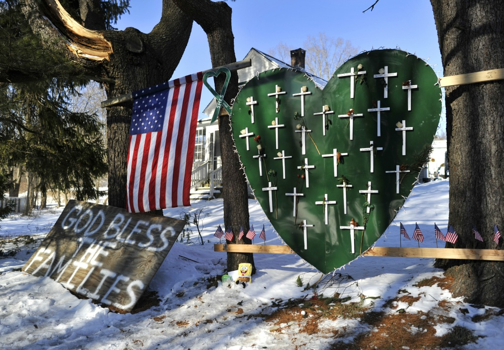 Some of the remaining memorial items to Sandy Hook Elementary students and staff who died are viewed in Newtown, Connecticut on January 3, 2013.