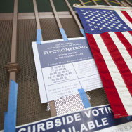 Election signs and a flag are posted on the gate at Angeles Mesa Elementary school during a special run-off election for the Los Angeles Unified School District board of education seat in District 1.