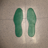 Footprints mark the spot where immigrants stand while taking eye tests at the Salud Family Health Clinic in Ft. Collins, Colo. The nonprofit provides health care to immigrants seeking asylum and migrant farm workers.