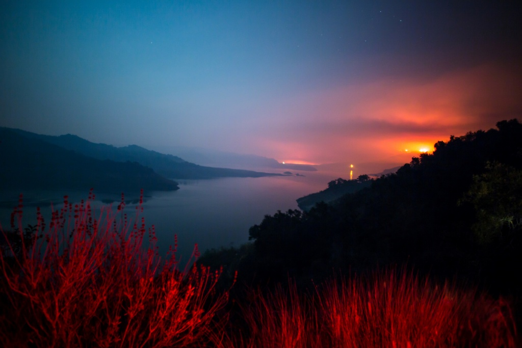 The Thomas Fire burns a hillside behind Lake Casitas in Ventura, California on December 8, 2017.