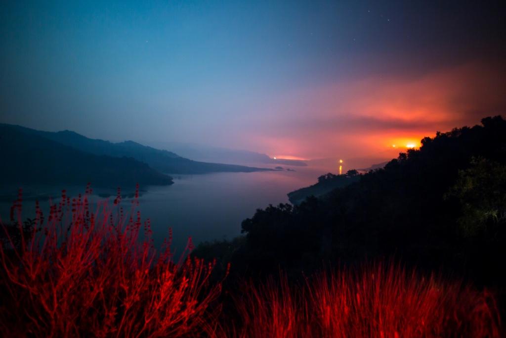 The Thomas Fire burns a hillside behind Lake Casitas in Ventura, California on December 8, 2017.