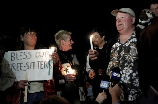 Protestor Camron Stone speaks during a candlelight vigil on Jan. 12, 2011 in support of tree-sitters who are attempting to keep oak trees from being felled in Arcadia.