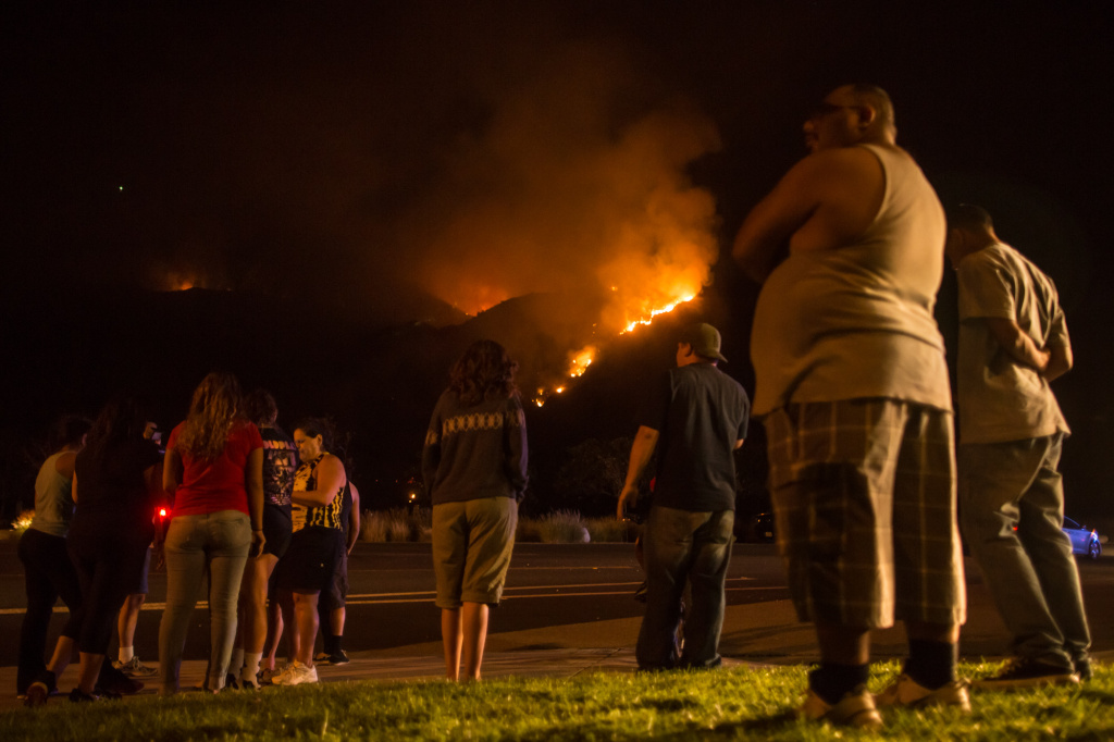 Azusa residents look on as a chopper drops water on the Madre Fire in the hills above Azusa.
