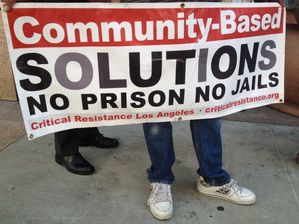 Inmate rights activists rallied in downtown LA against Governor Brown's plan to send prisoners out of state to comply with a federal court order.