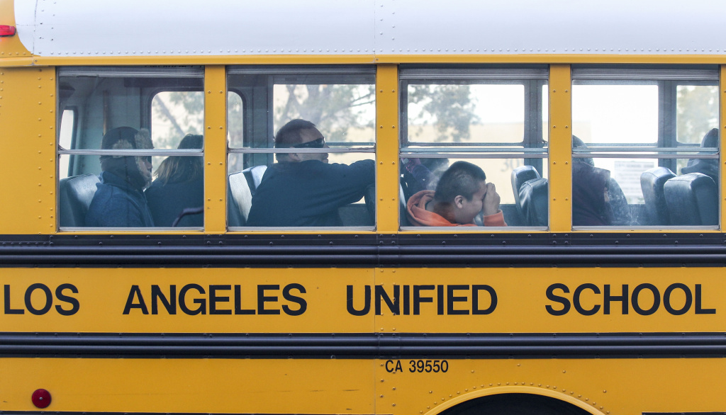 File: A school bus arrives at a school in Los Angeles on Dec. 16, 2015.