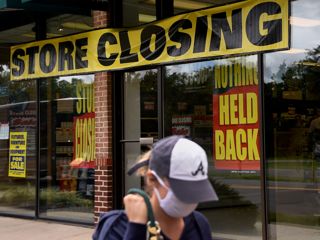 A store displays a sign before closing down permanently following the impact of the coronavirus pandemic, on Aug. 4, 2020 in Arlington, Va. The Small Business Administration's inspector general office said billions of dollars in relief loans may have been handed out to fraudsters or ineligible applicants.
