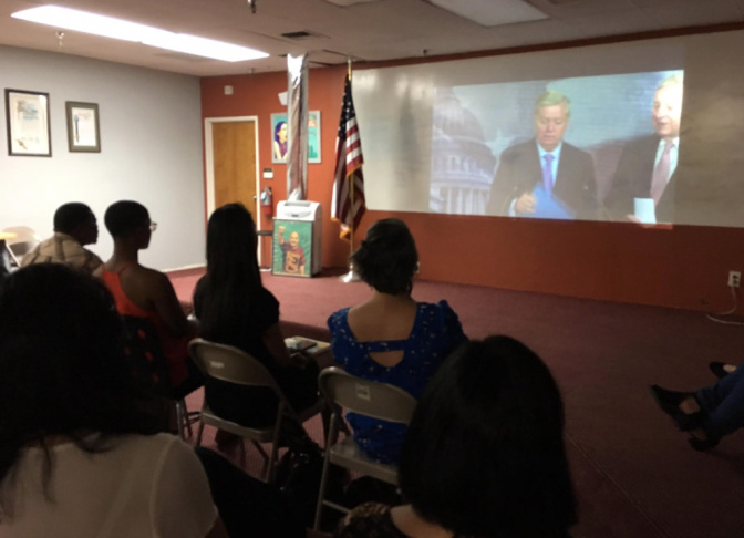 Young people watch at the offices of the Coalition for Humane Immigrant Rights of Los Angeles as U.S. Sen. Lindsey Graham and Dick Durbin unveil their new version of long-proposed legislation known as the DREAM Act on Thursday, July 20, 2017.