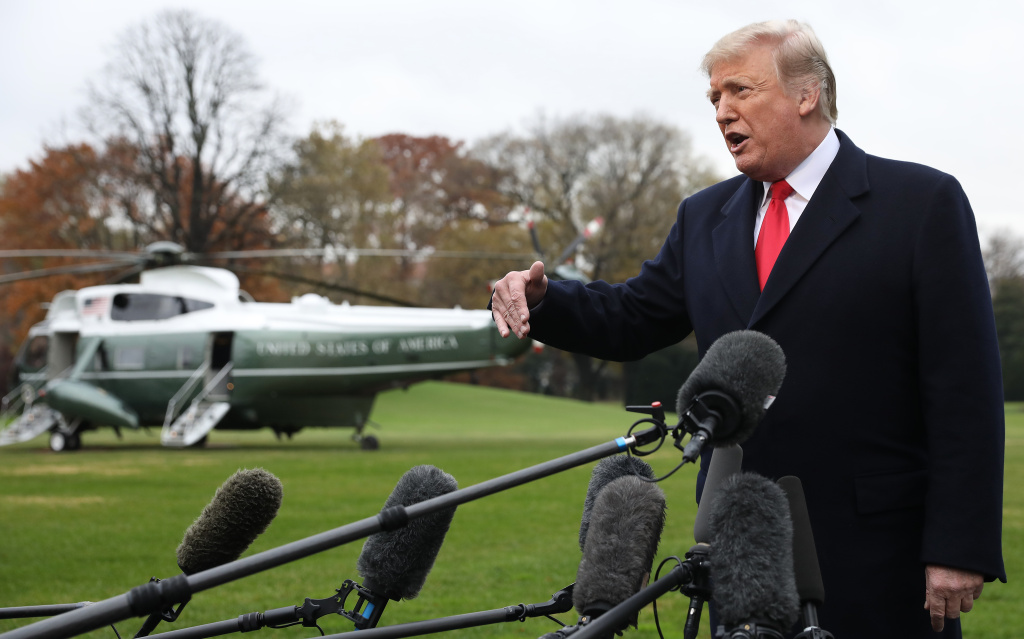 President Trump, seen answering questions outside the White House on Monday, is departing Thursday for Argentina to attend an international summit.