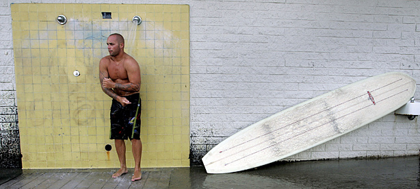 Surfer Tony Gamboa showers off the salt water after he finshed his day of surfing at Surfrider Beach August 4, 2005 in Malibu, California. An envriomental group has named Malibu's Surfrider Beach as the dirtiest beach in Los Angeles County.