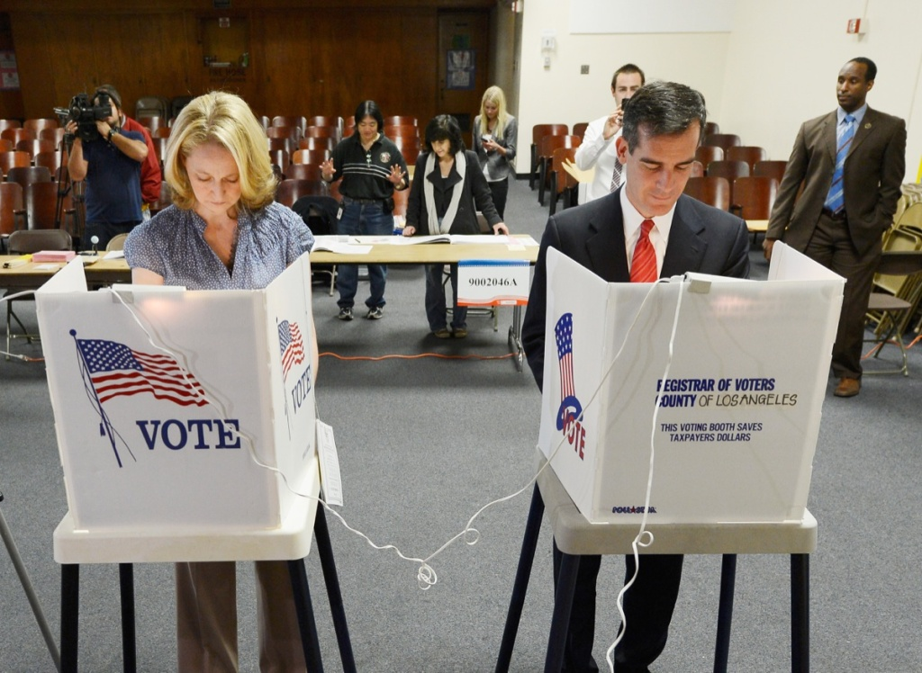 Candidate in the Los Angeles City mayoral race, Councilman Eric Garcetti and his wife Amy Wakeland cast their ballots at Allesandro Elementary School on March 5, 2013 in Boyle Heights area of Los Angeles.