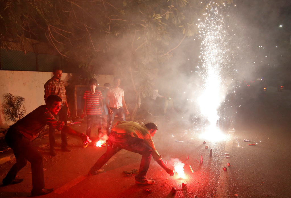 The fireworks of Diwali, the Hindu festival of lights, add smoke to the already polluted skies — and raise concerns about the impact of all that pollution on coronavirus cases. Here, a celebration takes place last year in Ahmedabad, India.