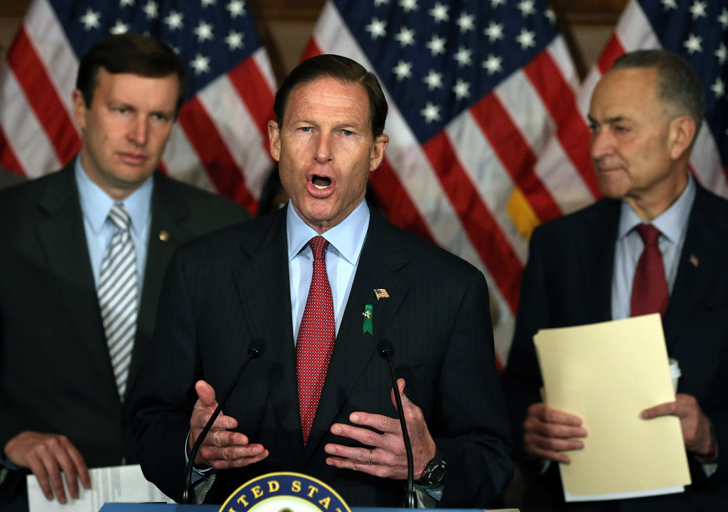 On April 11, 2013, Senators Richard Blumenthal (D-CT) (C), Christopher Murphy (D-CT) (L) and Charles Schumer (D-NY) participate in a news conference to urge their colleagues into passing tougher gun laws.