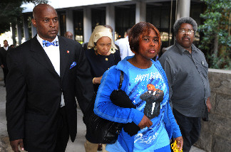 Wanda Johnson (2nd R), who is the mother of victim Oscar Grant, leaves a pretrial hearing for Johannes Mehserle, the former Bay Area Rapid Transit officer charged with murder in the shooting death of Grant in Oakland, California last year, at the Criminal Courts Building in Los Angeles on March 26, 2010.
