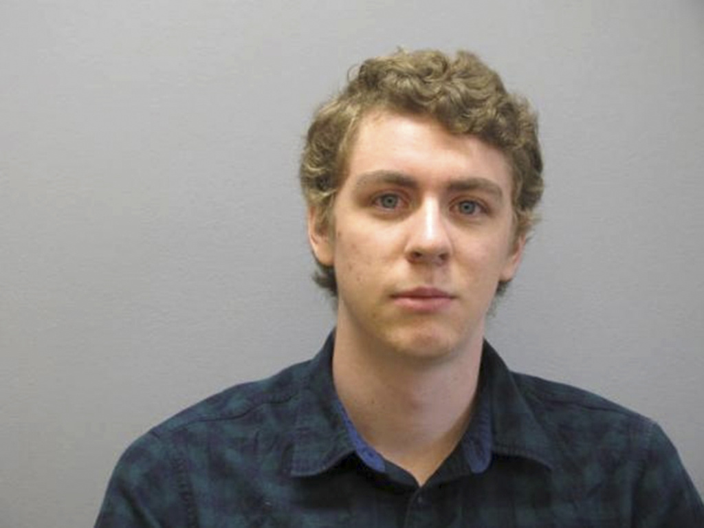 This Sept. 6, 2016 file photo released by the Greene County Sheriff's Office shows former Stanford University swimmer Brock Turner at the Greene County Sheriff's Office in Xenia, Ohio, where he officially registered as a sex offender.
