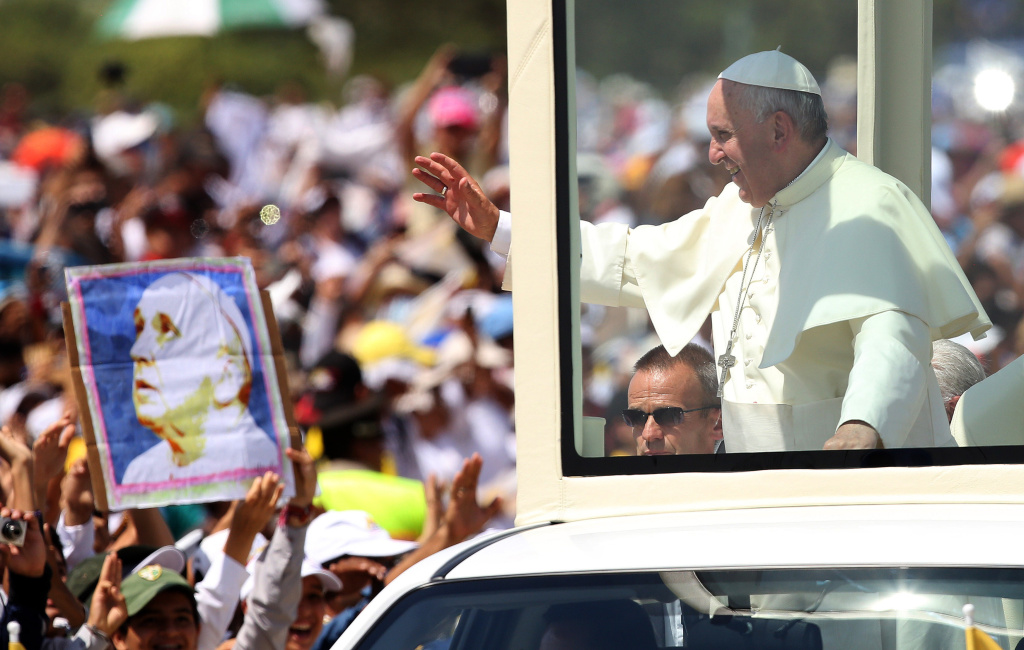 Pope Francis waves from the popemobile as he arrives to celebrate a Mass in  in Samanes Park, in Guayaquil, Ecuador, Monday, July 6, 2015. Latin America's first pope arrived in this port city on Monday for the first big event of a three-nation tour where he's set compassion for the weak and respect for the environment as central themes. (AP Photo/Fernando Vergara)