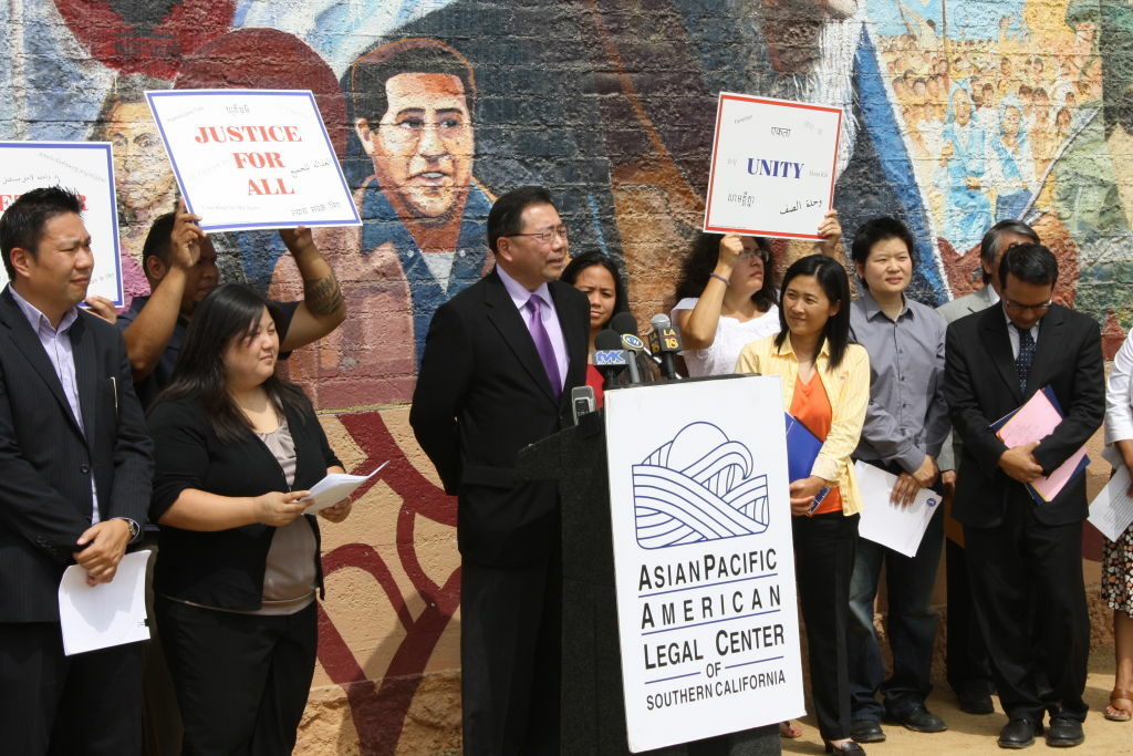 Connie Choi (second from left), an attorney with the the Asian Pacific American Legal Center, says  Asian-Americans have been particularly affected by a bill signed in 1996 by President Clinton making it easier to deport individuals who have committed minor crimes.
