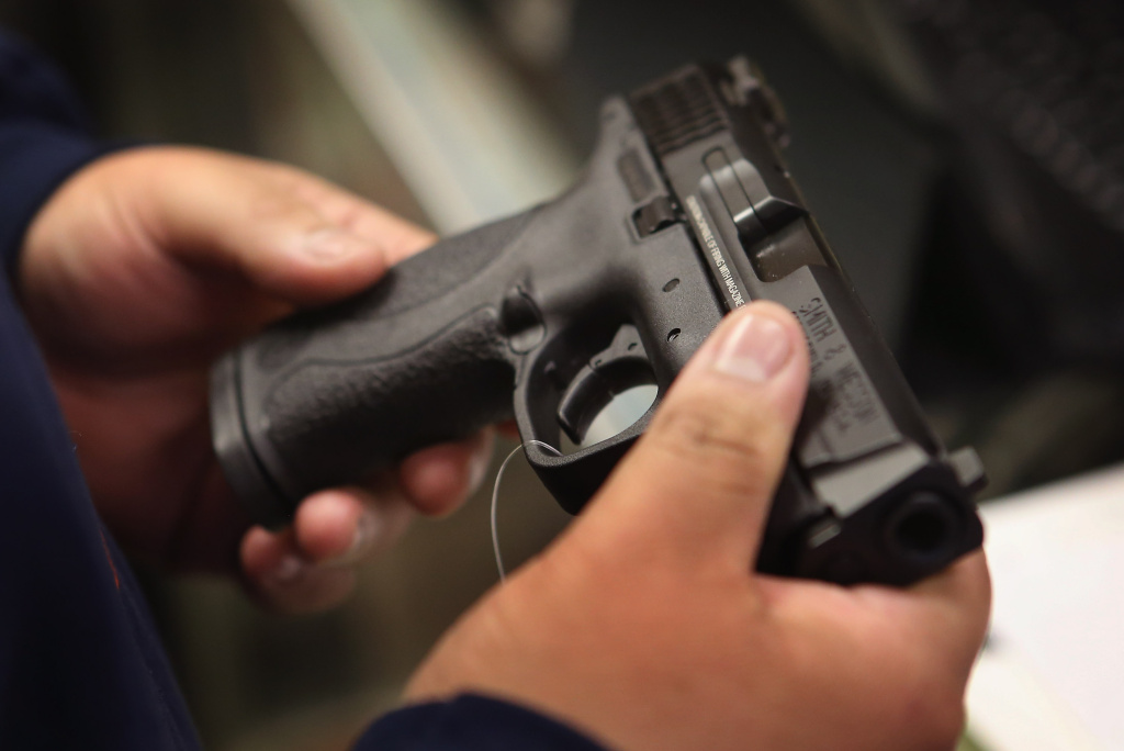 A customer shops for a pistol at Freddie Bear Sports sporting goods store on December 17, 2012 in Tinley Park, Illinois.