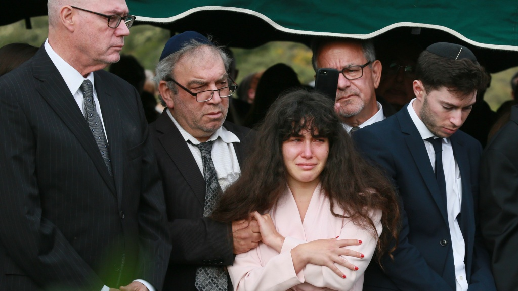 On Monday, members of the Kaye Family, including daughter Hannah, attended the burial service for Lori Kaye, who was killed in the Chabad of Poway synagogue shooting on Saturday. The shooter's parents have condemned the attack as shocking and evil.
