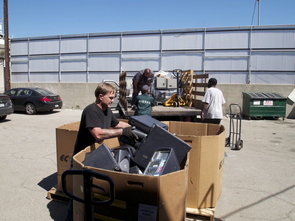Unloading a truckload of e-waste at Isidore Recycling Company in Los Angeles.