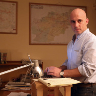 New York Times correspondent Matthew Rosenberg stands at his desk at the paper's office in Kabul on Wednesday. Afghanistan gave Rosenberg 24 hours to leave the country.