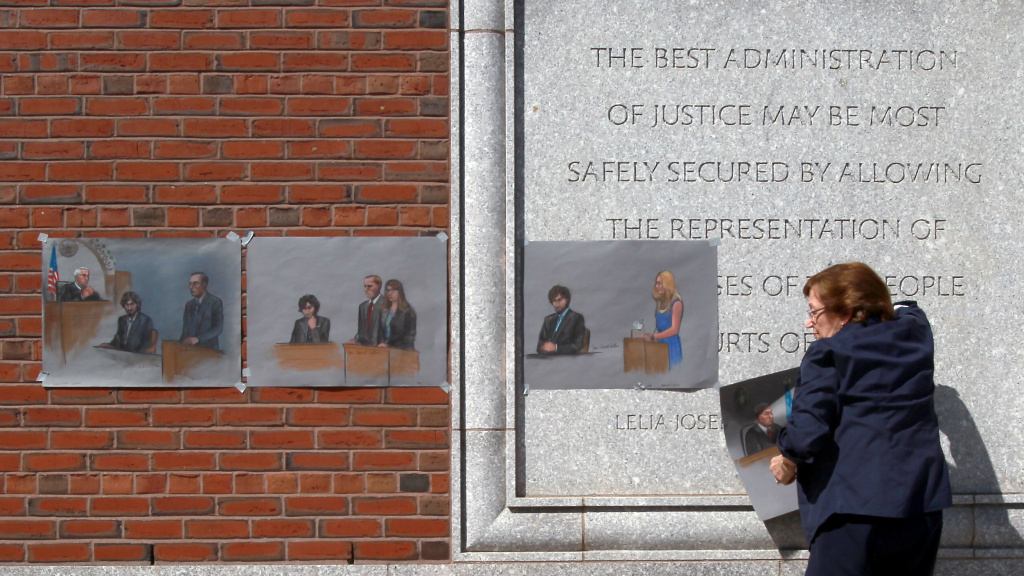 The U.S. Supreme Court will review a lower court's decision from last summer that vacated the death sentence of Boston Marathon bomber Dzhokhar Tsarnaev. Here, atist Jane Flavell Collins pulls down her courtroom sketches outside the Moakley federal courthouse in Boston after Tsarnaev was sentenced.