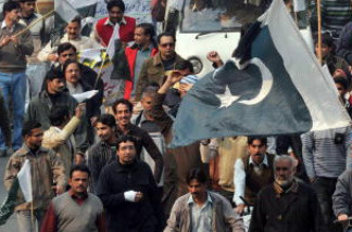 Demonstrators march in support of the Pakistan army during a protest against terrorism in Lahore on December 15, 2009.