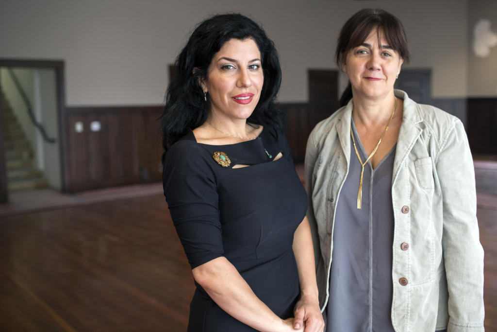 Museum Executive Director Marianna Gatto, left, and Francesca Guerrini, manager of programming and outreach, stand inside the renovated permanent exhibition wing at the Italian American Museum of Los Angeles on Wednesday morning, May 11, 2016.