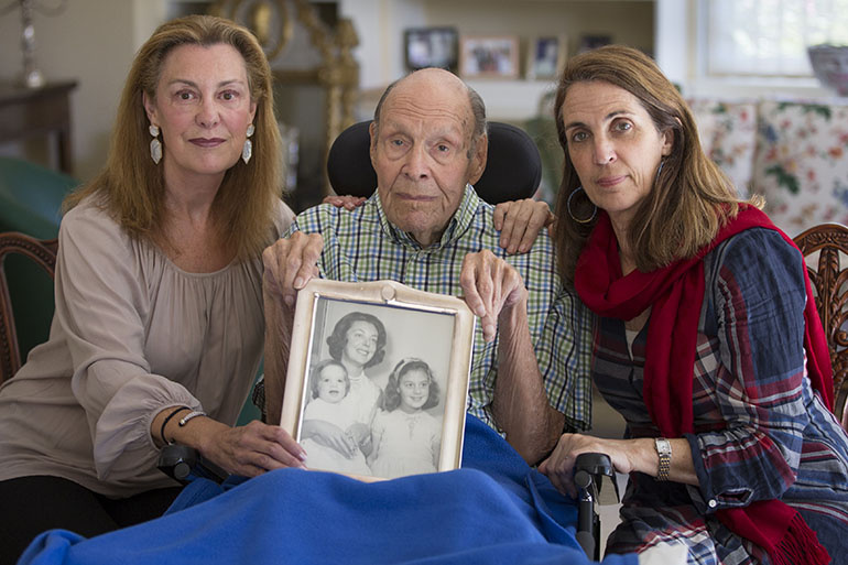 Laura Rees, left, her sister Nancy Fee, right, and their father, Joseph Fee, say that when Elizabeth Fee was ready to leave the hospital after surgery, they were not told that the nursing home had received poor marks from Medicare and state health inspectors. Elizabeth Fee, shown in an undated photo with her daughters, died in 2012 after suffering from an obstructed bowel while at the nursing home.