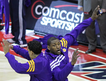 World Peace (right) getting pumped up before a game with team mate Matt Barnes 