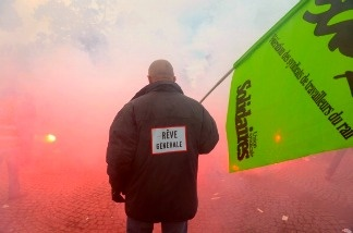 A man holds a Solidaires Union flag during a demonstration against the French government's pensions reform on October 19, 2010 in Paris.