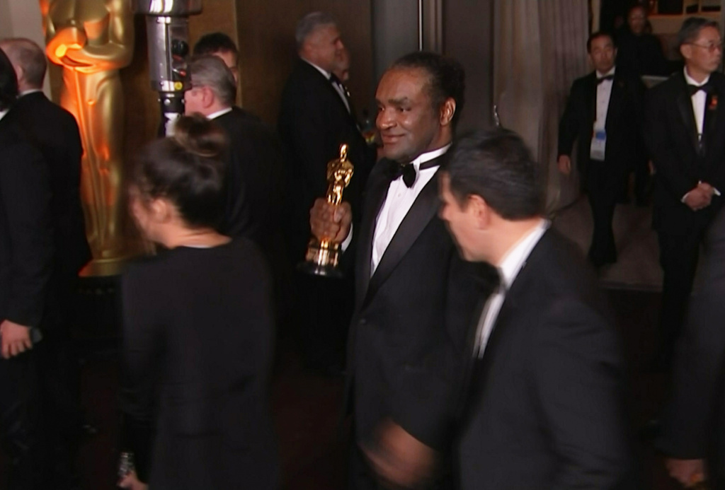 This Sunday, March 4, 2018, still image from AP video appears to show the man who authorities say stole Frances McDormand's best actress Oscar walking out of the official Academy Awards after-party in Los Angeles.