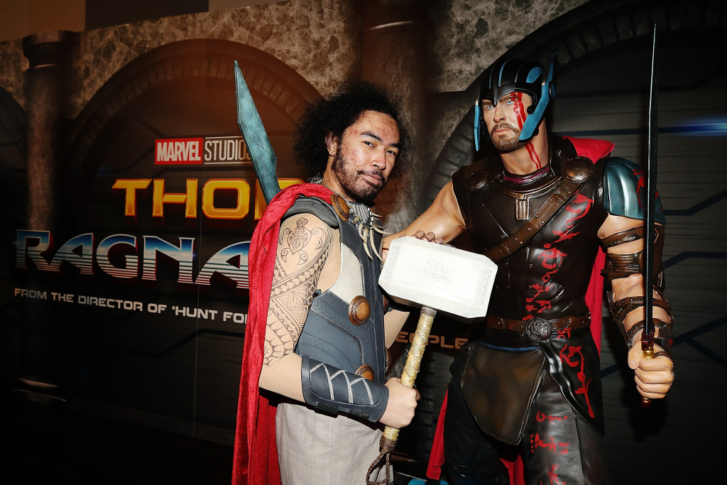 A fan poses at Marvel Studios Thor: Ragnarok booth at Armageddon on October 21, 2017 in Auckland, New Zealand.