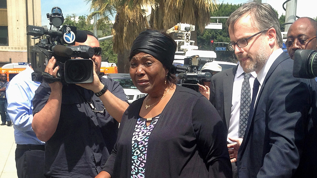 Heleine Tchayou, center, the mother of Charly Leundeu Keunang, a homeless man who was shot and killed during a confrontation on Skid Row by Los Angeles police, arrives at a news conference in Los Angeles in 2015. On Tuesday, the Los Angeles City Council approved a $1.9 million settlement with Keunang's family.