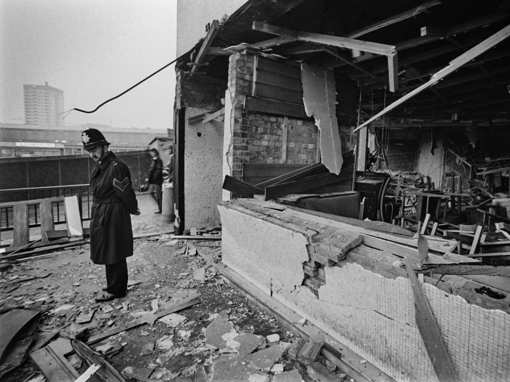 A police officer stands before damage caused by one of two pub bombings in 1974 in Birmingham, England.