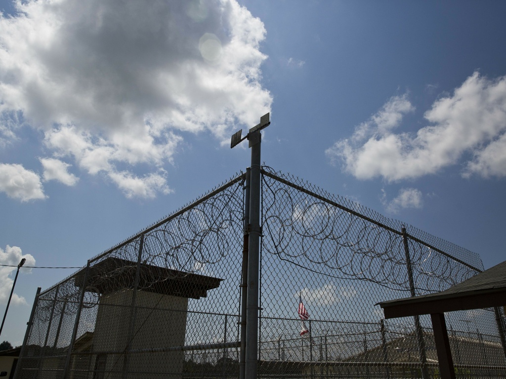 A fence stands at Elmore Correctional Facility in Elmore, Ala., seen in 2015. A federal judge ruled that mental health care for inmates is