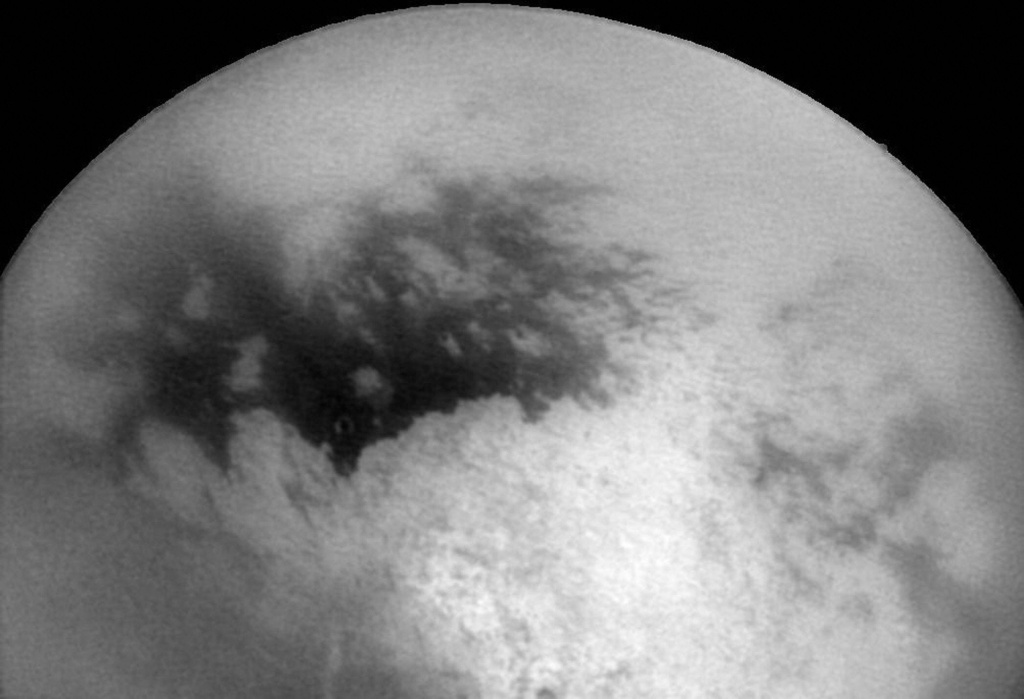This NASA Cassini Spacecraft image released 14 December, 2004, shows Saturn's moon Titan as Cassini approached it 11 December for its second close encounter with the intriguing moon. The bright and dark regions near the center of the frame are features on Titan's surface.