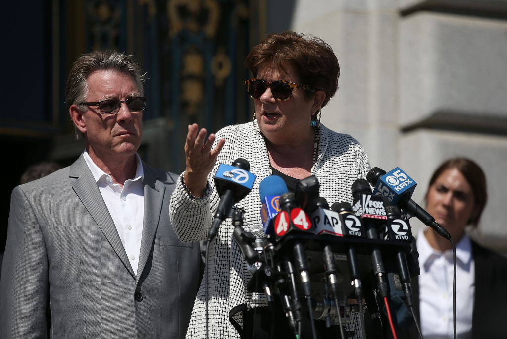 Liz Sullivan and Jim Steinle, the parents of Kate Steinle, who was killed by an undocumented immigrant, speak during a news conference on September 1, 2015 in San Francisco, California.