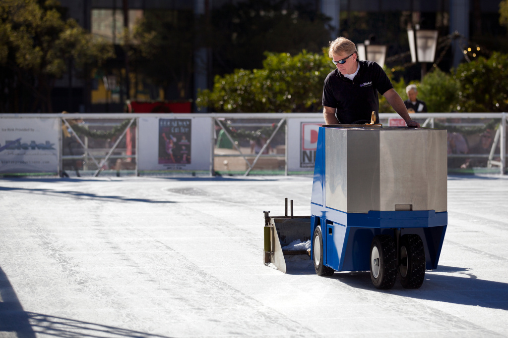 A worker smooths the ice on a zamboni in between sessions during Downtown on Ice at Pershing Square on Christmas Eve.