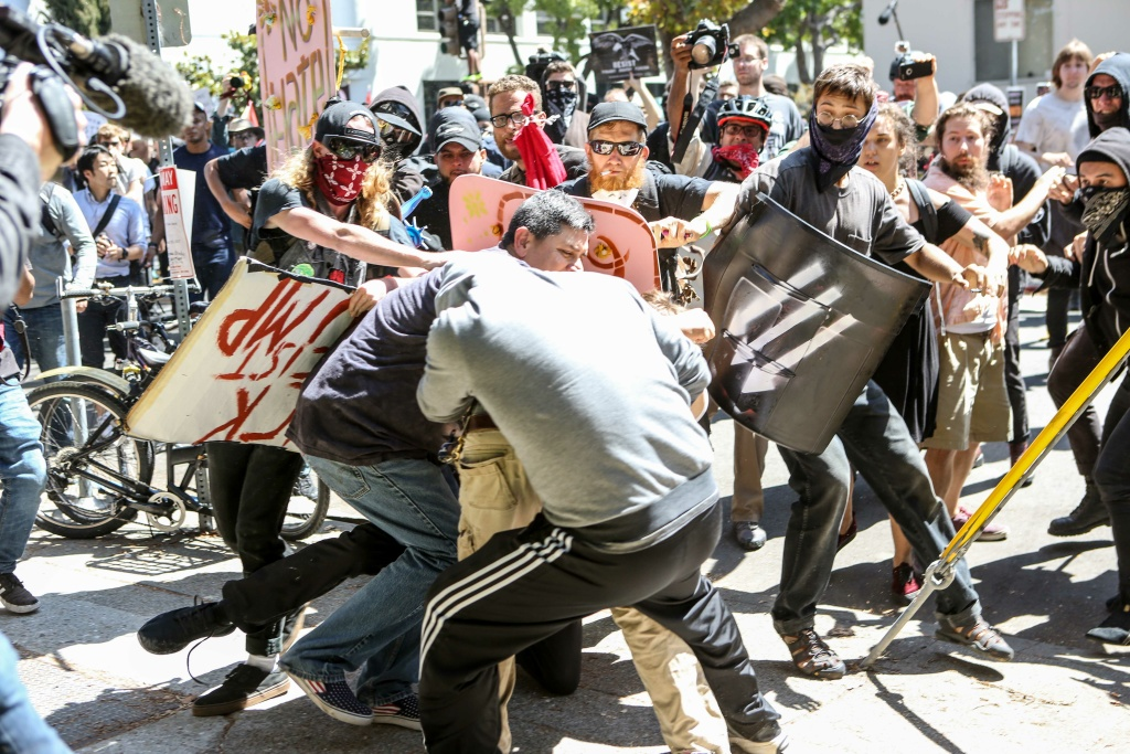 No-To-Marxism rally members and counter protesters clash on August 27, 2017 at Martin Luther King Park Jr. Civic Center Park in Berkeley, California.