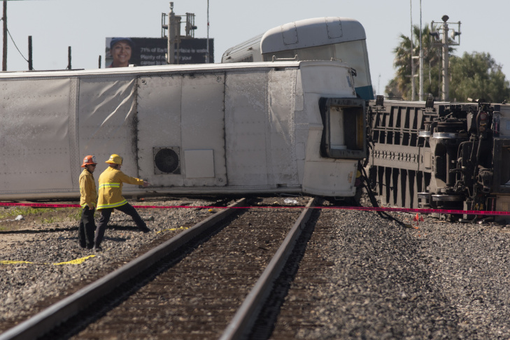 The burned remains of a truck are seen at the site where a Los Angeles-bound Metrolink train derailed in a fiery collision with a truck on the tracks on Feb. 24, 2015 in Oxnard, California.