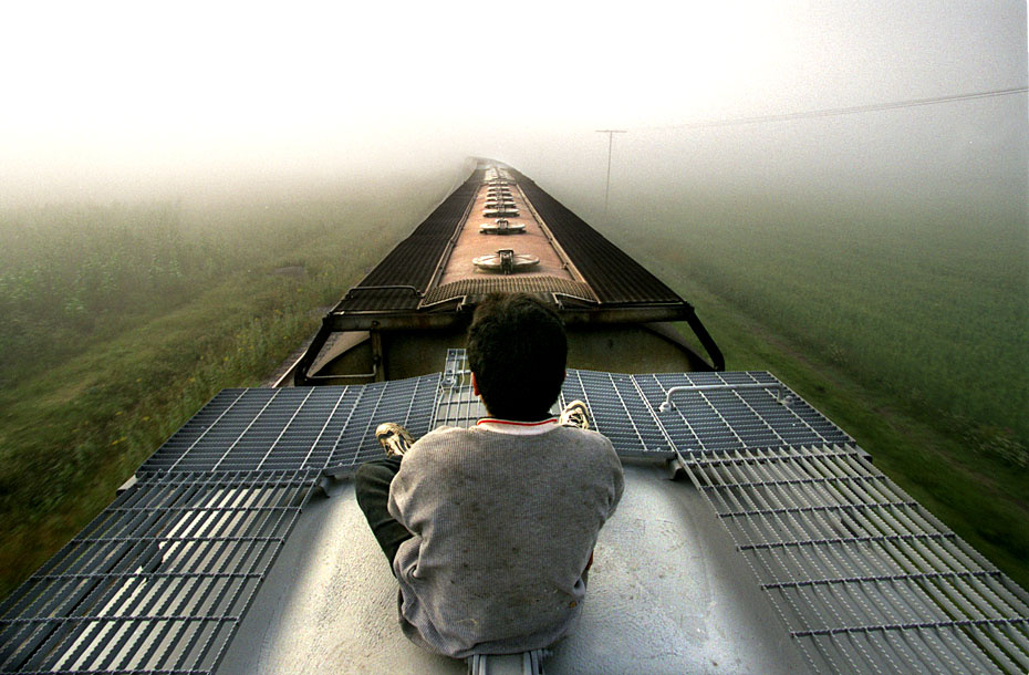 In the vast migration that is changing the U.S., a Honduran boy rides a freight train through Mexico. Each year thousands of Central Americans stow away for 1,500 miles on the tops and sides of trains. Some are parents desperate to escape poverty. Many are children in search of a parent who left them behind long ago. Only the brave and the lucky reach their goal.