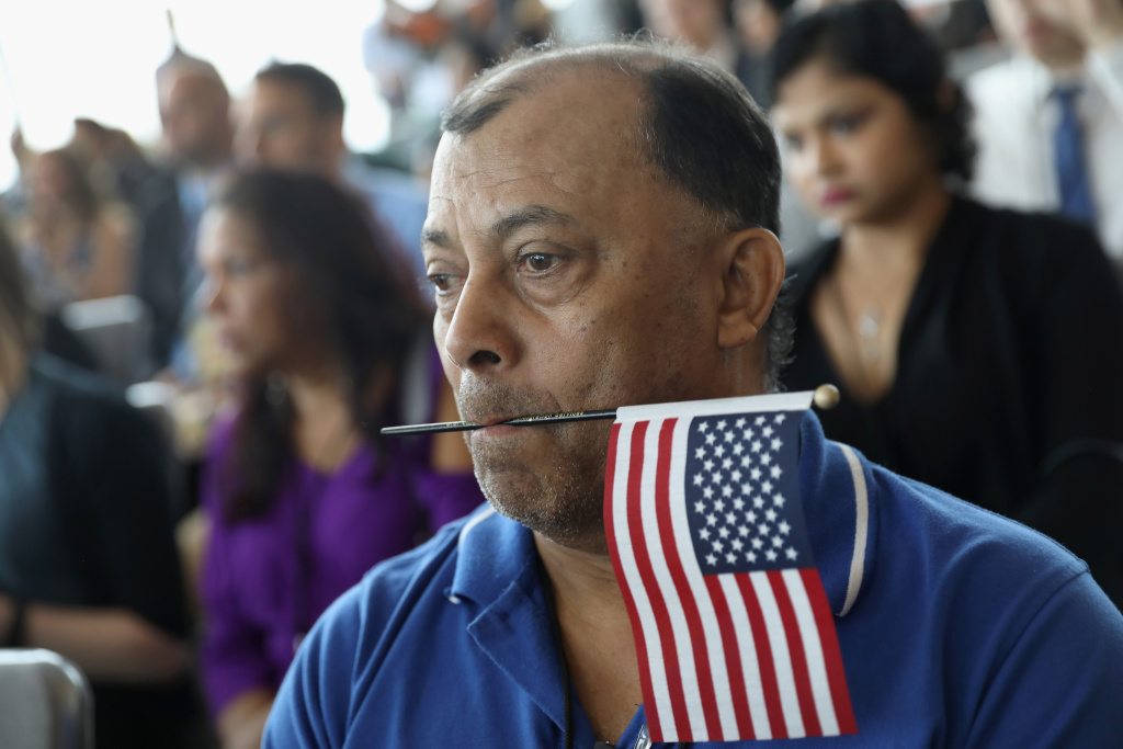 This file photo shows a man at a citizenship ceremony.