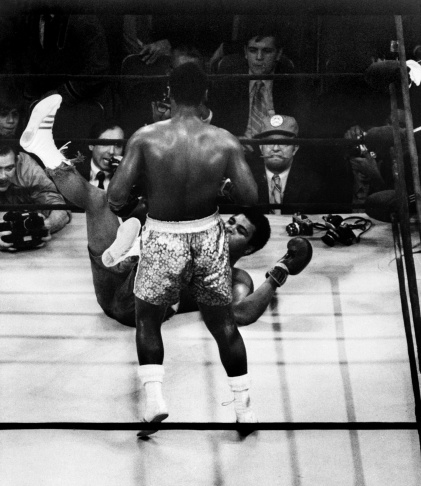 FILE - In this March 8, 1971, file photo, Muhammad Ali takes a left from Joe Frazier during the 15th round of their heavyweight title boxing bout in New York. Frazier won a unanimous decision. Prime seats were $150 — an astonishing sum at the time — and they could have sold them for twice that price.