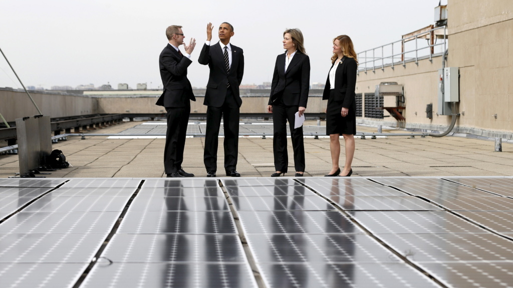 President Barack Obama, seen here inspecting solar panels on the roof of the Department of Energy, has submitted a U.S. pledge to reduce greenhouse gases.