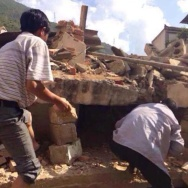 Residents look for survivors in the rubble of a collapsed house after a 6.1-magnitude earthquake hit the area in Ludian county in Zhaotong, southwest China's Yunnan province Sunday. The quake hit at a relatively shallow depth of about 6 miles.