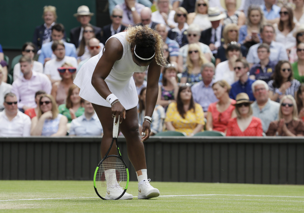 Serena Williams is dejected after losing a point during the women's singles final match against Romania's Simona Halep at Wimbledon on July 13, 2019.